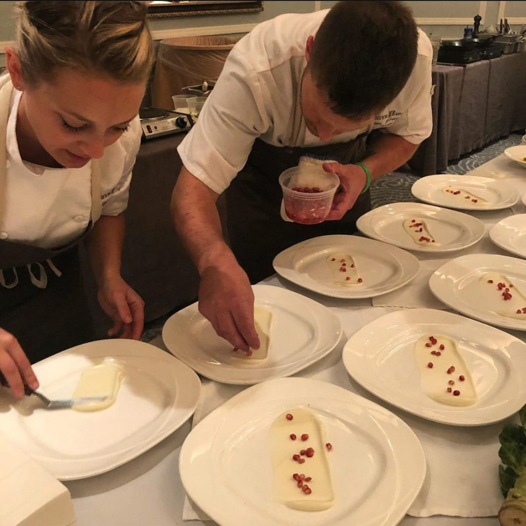 Chef Mel plating up dinner with Chef Sam from White Birch Restaurant