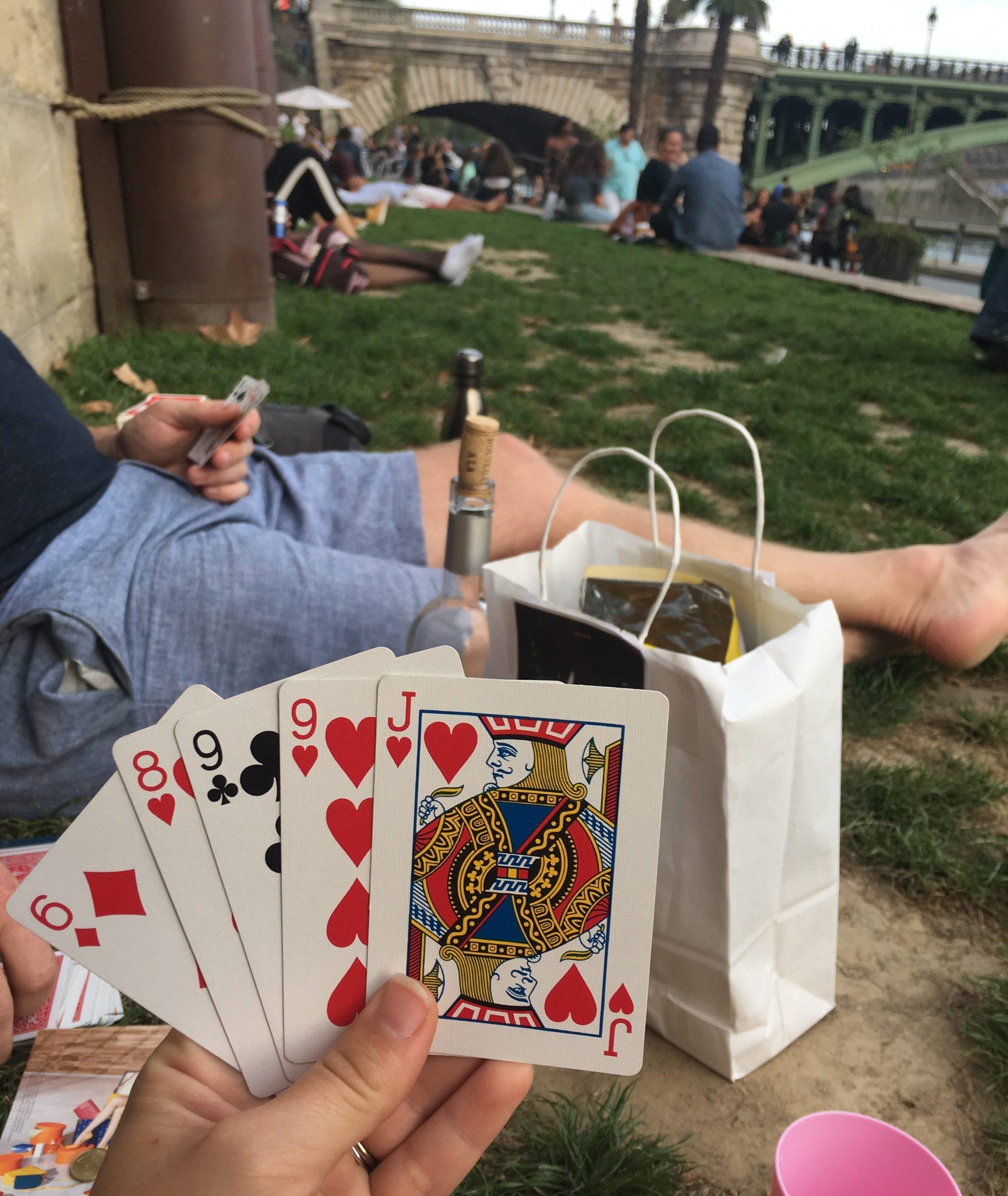 """By the seine river playing cards with wine and eating savory crêpes au Fromage or """"Crepe with cheese"""""""