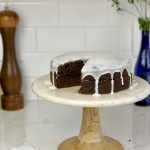 Vegan chocolate cake with berry jam and vanilla coconut glaze